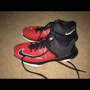 Nike Air Versatile two in red and black.